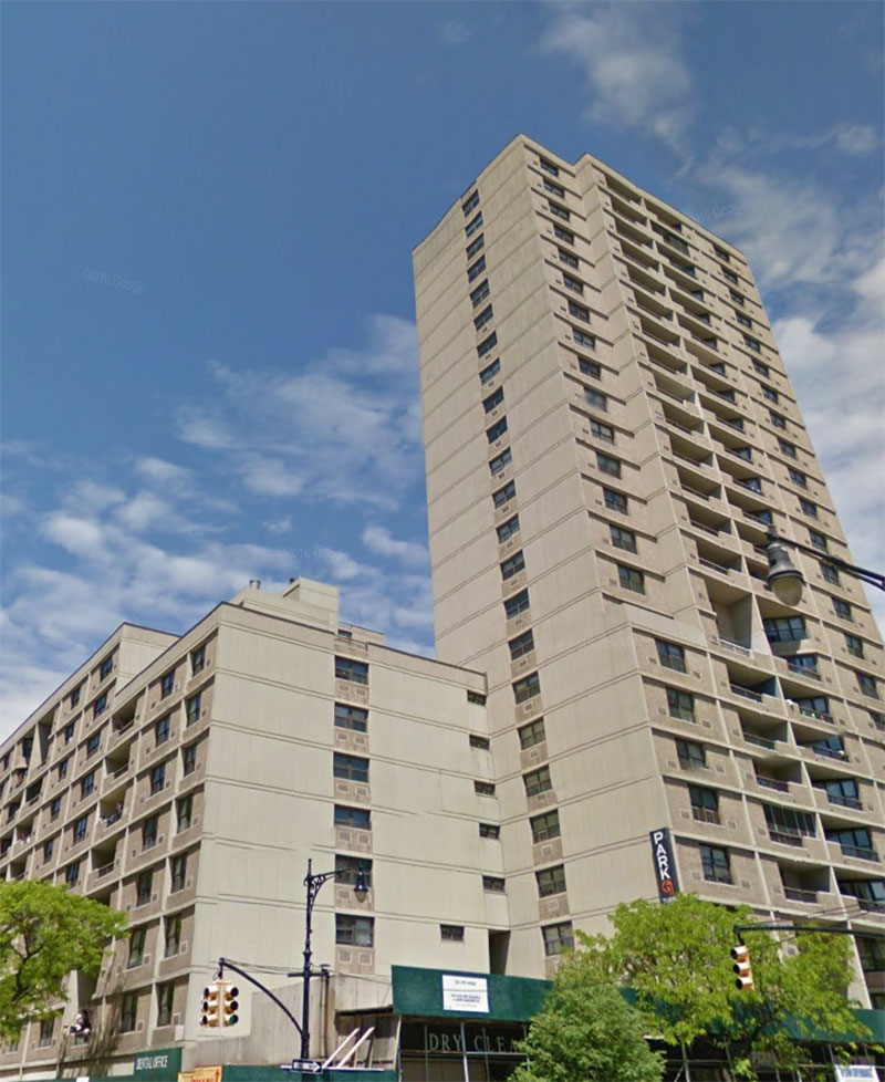 A photo of Lakeview Apartments in NYC from the street looking up.