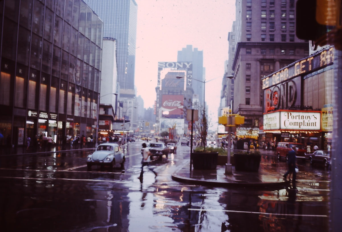 A photo of Times Square in the rain circa 1970s.